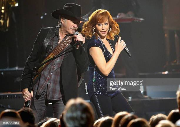 Kix Brooks of Brooks and Dunn and recording artist Reba McEntire perform onstage at the 49th annual CMA Awards at the Bridgestone Arena on November 4...