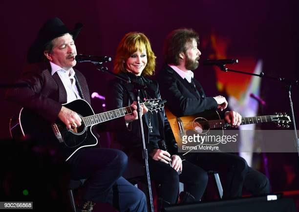Kix Brooks of Brooks and Dunn Reba McEntire and Ronnie Dunn of Brooks and Dunn perform onstage at Celebrity Fight Night XXIV on March 10 2018 in...