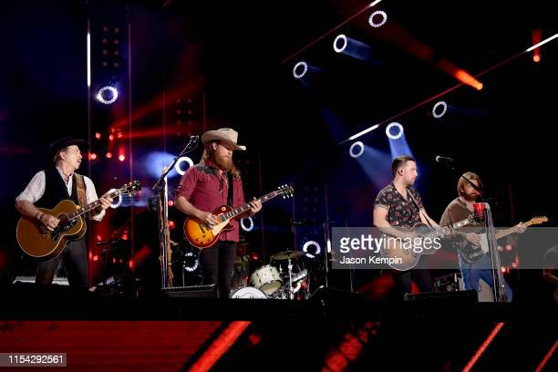 Kix Brooks of musical duo Brooks and Dunn and John Osborne and TJ Osborne of musical duo Brothers Osborne and Ronnie Dunn perform on stage during day...