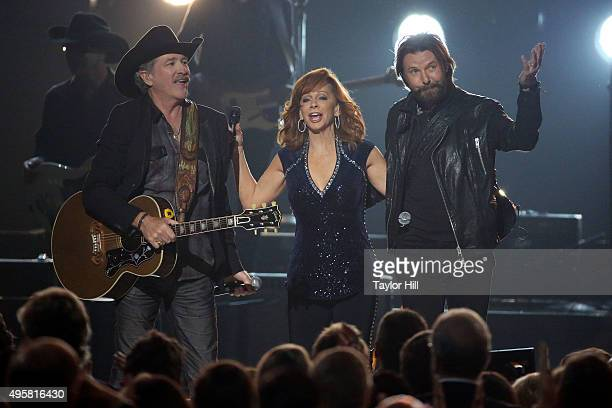 Kix Brooks Reba McEntire and Ronnie Dunn perform during the 49th annual CMA Awards at the Bridgestone Arena on November 4 2015 in Nashville Tennessee