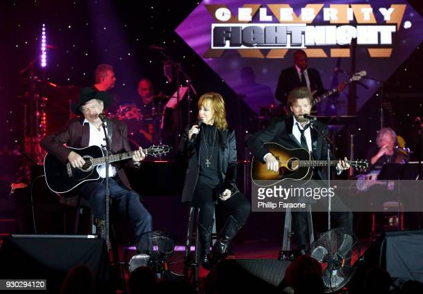 Kix Brooks Reba McEntire and Ronnie Dunn perform onstage at Celebrity Fight Night XXIV on March 10 2018 in Phoenix Arizona