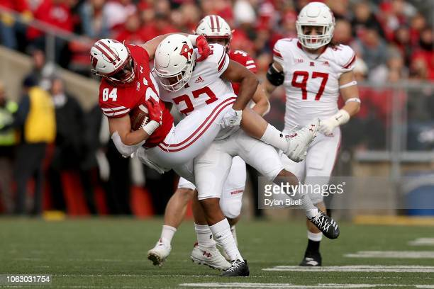 Kiy Hester of the Rutgers Scarlet Knights tackles Jake Ferguson of the Wisconsin Badgers in the first quarter at Camp Randall Stadium on November 03...