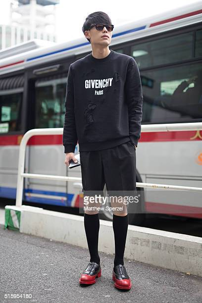 Kiyohiro Yamaguchi attends the Bennu show during Tokyo Fashion Week wearing a Givenchy sweater Prada shoes and Tom Ford glasseson March 16 2016 in...
