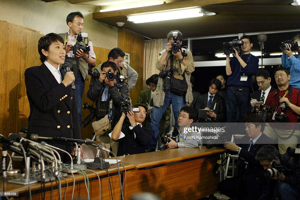 Kiyomi Tsujimoto, an opposition Social Democratic Party (SDP) lawmaker, removes her lawmaker's pin from her lapel during a news conference at the SDP headquarters March 26, 2002 in Tokyo, Japan. Tsujimoto resigned from parliament after her own party acknowledged crooked bookkeeping at her office.