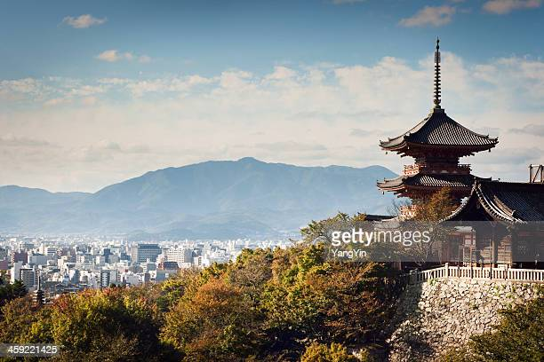 kiyomizu-dera temple buildings with kyoto, japan city skyline and mountains - kyoto japan stock photos and pictures
