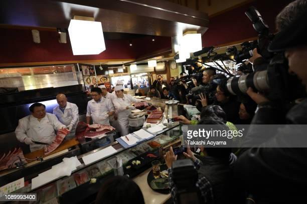 Kiyomura Co President Kiyoshi Kimura cuts a fresh bluefin tuna at one of the company's Sushi Zanmai sushi restaurants after the year's first auction...