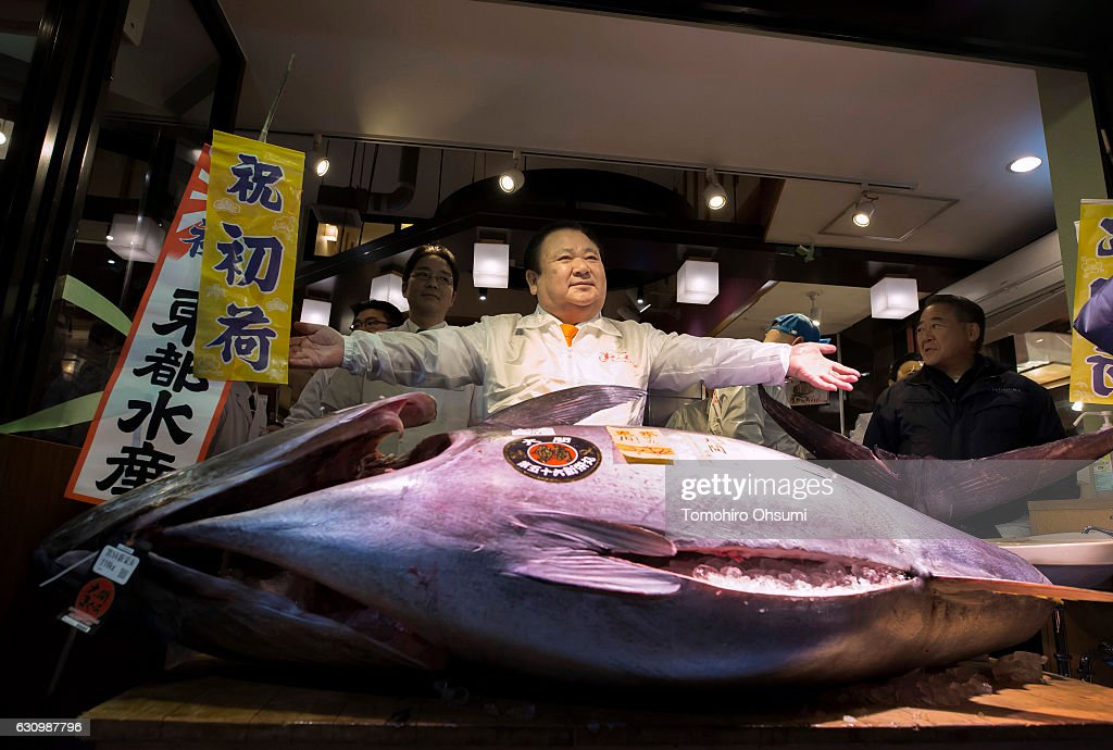 Kiyomura Co. President Kiyoshi Kimura poses with a fresh bluefin tuna in front of one of the company's Sushi Zanmai sushi restaurants after the year's first auction at Tsukiji Market on January 5, 2017 in Tokyo, Japan. Kiyomura Co. bid the highest priced tuna weighing 212 kilogram (467.38 pound) for 74.2 million yen ($637,155) at the year's first auction.