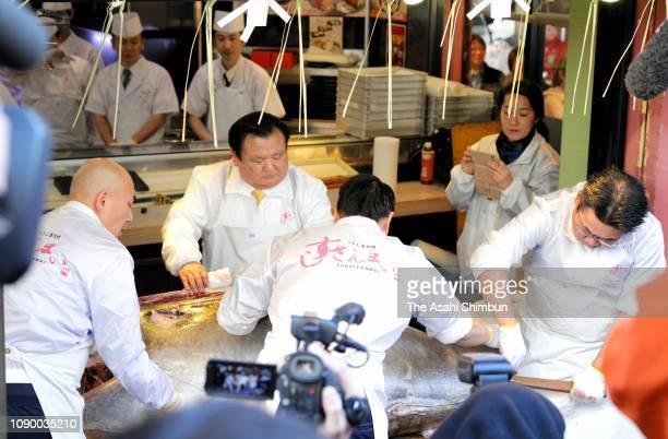 Kiyoshi Kimura president of Kiyomura Corp cuts the bluefin tuna on which he bid a record 3336 million yen at the first tuna auction of the New Year...