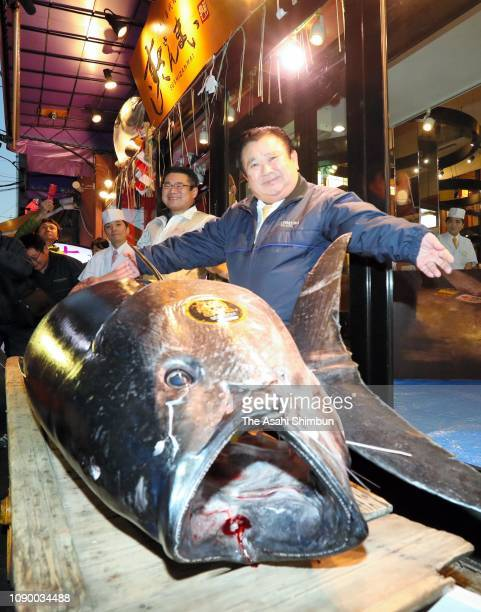 Kiyoshi Kimura president of Kiyomura Corp shows off the bluefin tuna on which he bid a record 3336 million yen at the first tuna auction of the New...