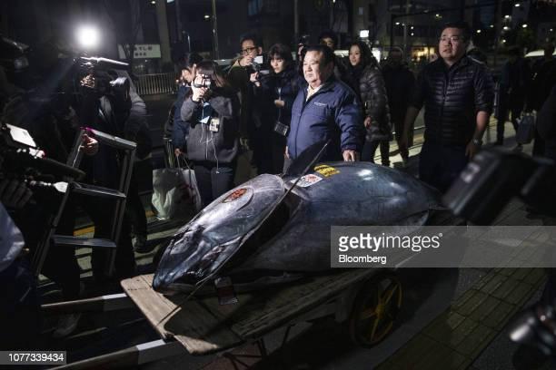 Kiyoshi Kimura president of Kiyomura Corp walks with a newlypurchased tuna towards a Sushizanmai restaurant in Tokyo Japan on Saturday Jan 5 2019...