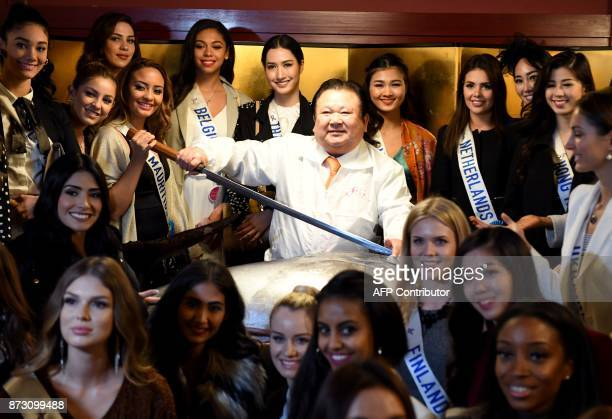 Kiyoshi Kimura president of sushi restaurant chain SushiZanmai poses with a 250kilogram bluefin tuna and Miss International Beauty Pageant...