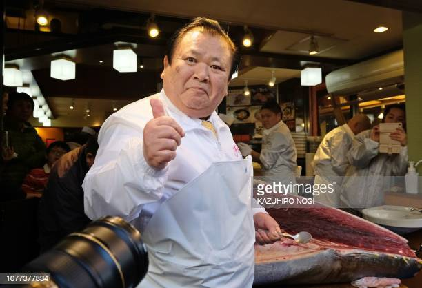 Kiyoshi Kimura president of sushi restaurant chain SushiZanmai reacts after a tuna fillet tasting of a 278kg bluefin tuna at his main restaurant in...