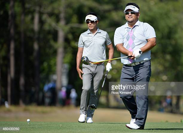 Kiyoshi Miyazato of Japan and Azuma Yano of Japan look on from a tee during a practice round prior to the start of the 114th U.S. Open at Pinehurst...