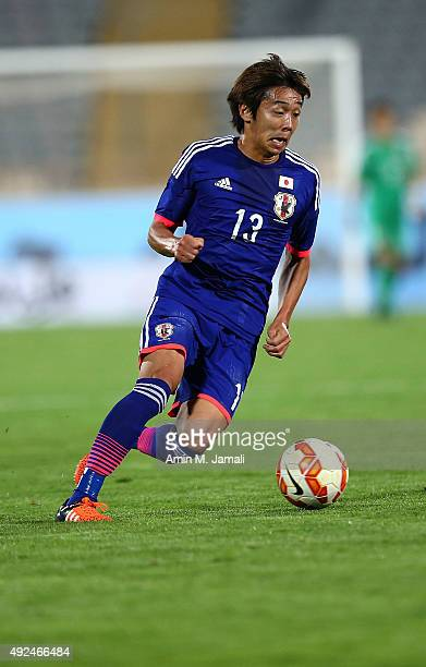 Kiyotake Hiroshi in action during the international friendly match between Iran and Japan at Azadi Stadium on October 13 2015 in Tehran Iran