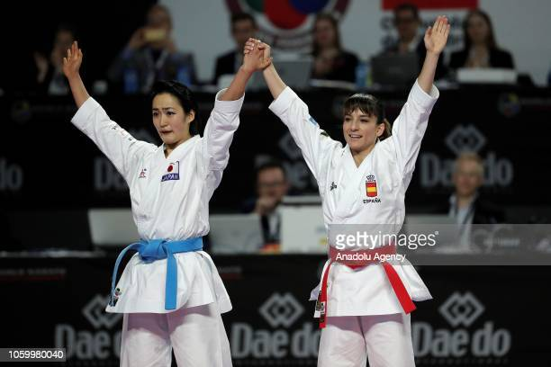 Kiyou Shimizu of Japan and Sandra Sanchez of Spain greet people after their Women's Individual Kata gold medal match within the 24th Karate World...