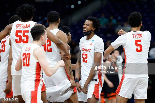 Kiyron Powell of the Houston Cougars celebrates with teammates after defeating Oregon State Beavers in the Elite Eight round of the 2021 NCAA Men's...