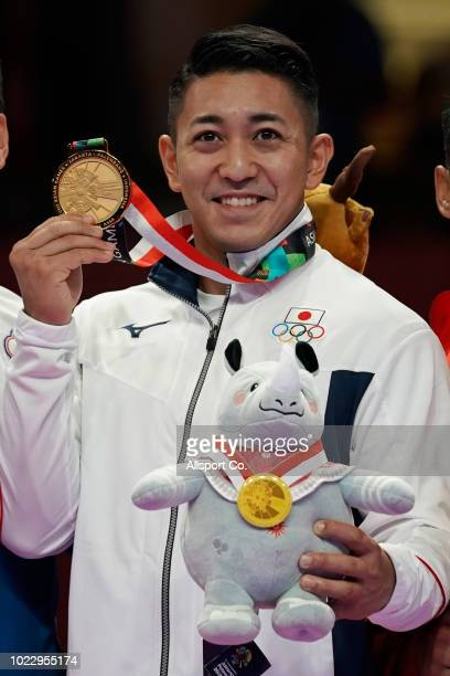 Kiyuna Ryo of of Japan poses with his gold medal after the Men's Karate Kata final at the JCC PLenary Hall on day seven of the18th Asian Games on...