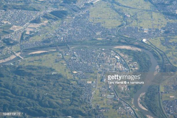 Kizugawa city in Kyoto prefecture in Japan daytime aerial view from airplane