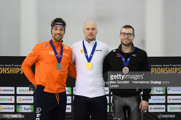 Kjeld Nuis of the Netherlands Pavel Kulizhnikov of Russia and Laurent Dubreuil of Canada stand on the podium after the men's 1000 meter during the...