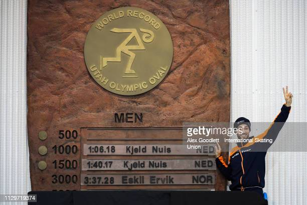 Kjeld Nuis of the Netherlands stands next to his 1000m and 1500m world record signs duing the ISU World Cup Final at the Utah Olympic Oval on March...