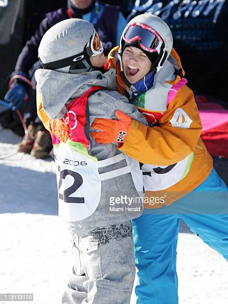 Kjersti Buaas of Norway left is greeted by Cheryl Maas of the Netherlands after Buaas completed her run for a bronze medal in the ladies' halfpipe...