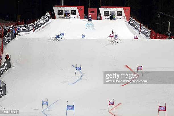 Kjetil Jansrud of Norway Carlo Janka of Switzerland in action during the Audi FIS Alpine Ski World Cup Men's Parallel Giant Slalom on December 19...