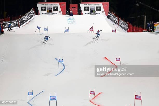 Kjetil Jansrud of Norway Leif Kristian Haugen of Norway compete during the Audi FIS Alpine Ski World Cup Men's Parallel Giant Slalom on December 19...