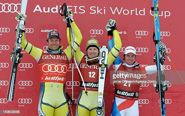Kjetil Jansrud of Norway takes 1st place, Aksel Lund Svindal of Norway takes 2nd place, Beat Feuz of Switzerland takes 3rd place competes during the...