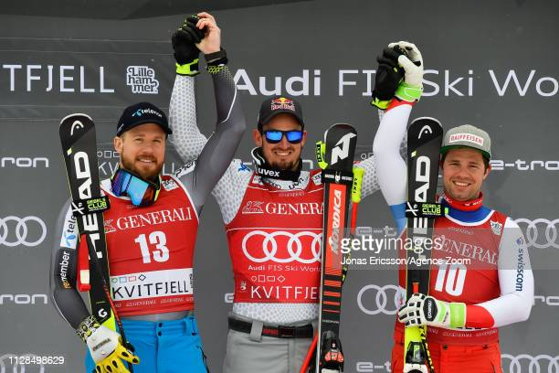 Kjetil Jansrud of Norway takes 2nd place Dominik Paris of Italy takes 1st place Beat Feuz of Switzerland takes 3rd place during the Audi FIS Alpine...