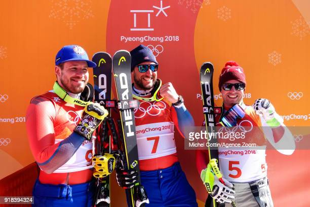 Kjetil Jansrud of Norway wins the silver medal Aksel Lund Svindal of Norway wins the gold medal Beat Feuz of Switzerland wins the bronze medal during...