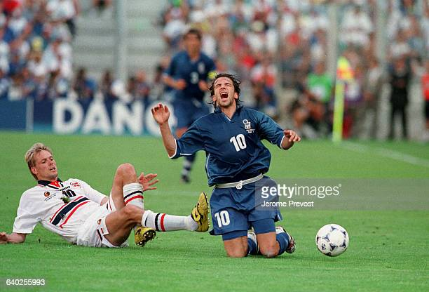 Kjetil Rekdal tackles Alessandro Del Piero during the quarterfinal match of the 1998 World Cup soccer championship