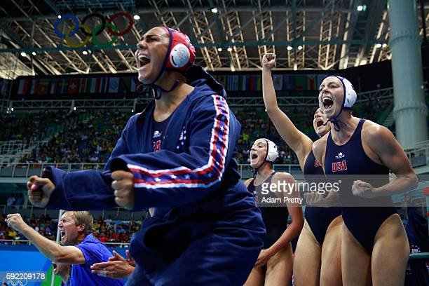 Kk Clark of United States and Sami Hill of United States celebrate on the bench during the Women's Water Polo Gold Medal match between the United...