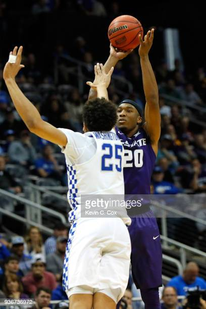 kk20 shoots against PJ Washington of the Kentucky Wildcats in the second half during the 2018 NCAA Men's Basketball Tournament South Regional at...