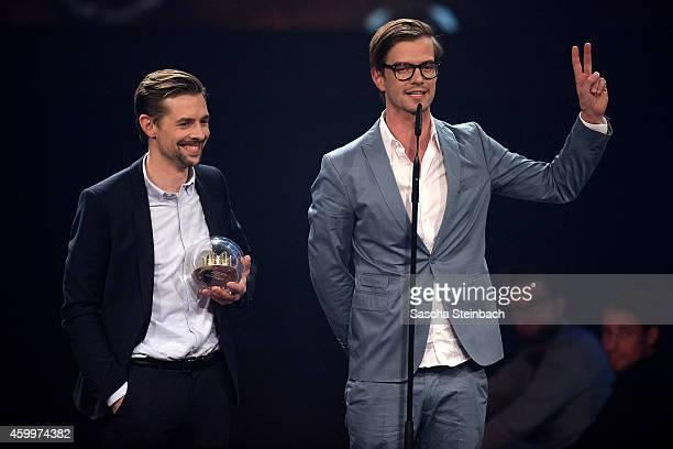 Klaas HeuferUmlauf and Joko Winterscheidt celebrate winning the 1Live Krone award during the 1Live Krone 2014 at Jahrhunderthalle on December 4 2014...