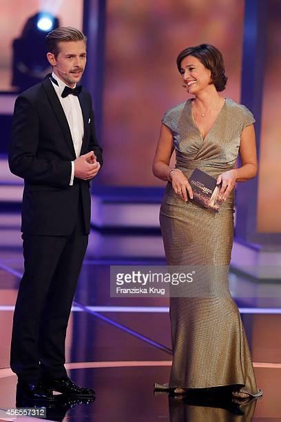 Klaas HeuferUmlauf and Sandra Maischberger attend the Deutscher Fernsehpreis 2014 show on October 02 2014 in Cologne Germany