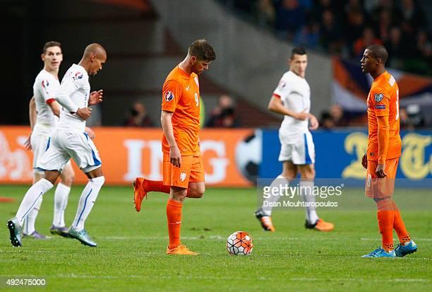 Klaas Jan Huntelaar and Georginio Wijnaldum of the Netherlands look dejected as Josef Sural of the Czech Republic