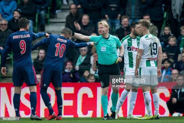 Klaas Jan Huntelaar of Ajax Hakim Ziyech of Ajax referee Kevin Blom Mimoun Mahi of FC Groningen Tom van Weert of FC Groningen during the Dutch...