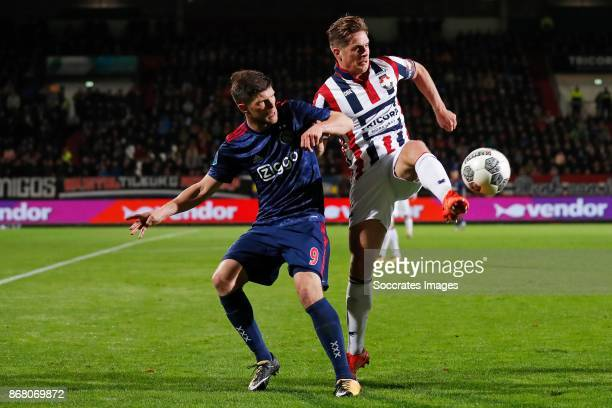 Klaas Jan Huntelaar of Ajax Jordens Peters of Willem II during the Dutch Eredivisie match between Willem II v Ajax at the Koning Willem II Stadium on...