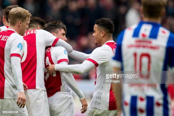 Klaas Jan Huntelaar of Ajax Nicolas Tagliafico of Ajax Justin Kluivert of Ajax 21 during the Dutch Eredivisie match between Ajax Amsterdam and sc...