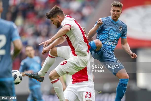 Klaas Jan Huntelaar of Ajax Peter van Ooijen of Heracles Almelo during the Dutch Eredivisie match between Ajax Amsterdam and Heracles Almelo at the...