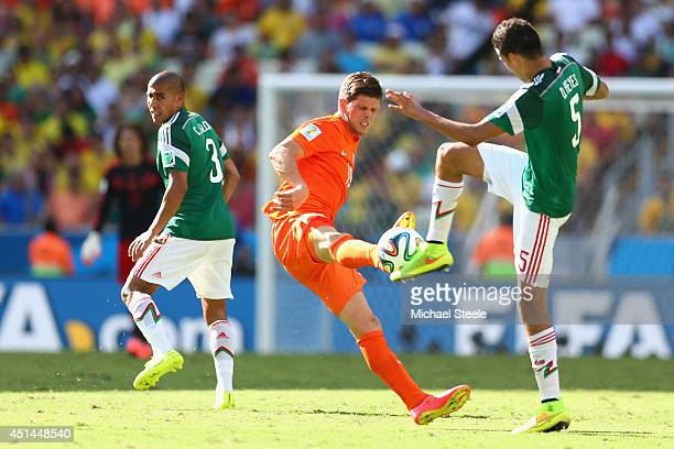 Klaas Jan Huntelaar of Netherlands challenges Diego Reyes of Mexico during the 2014 FIFA World Cup Brazil round of 16 match between Netherlands and...