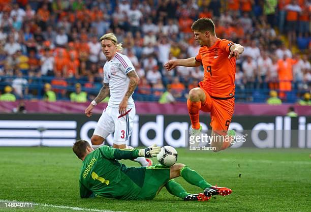 Klaas Jan Huntelaar of Netherlands tries to chip the ball over goalkeeper Stephan Andersen of Denmark during the UEFA EURO 2012 group B match between...