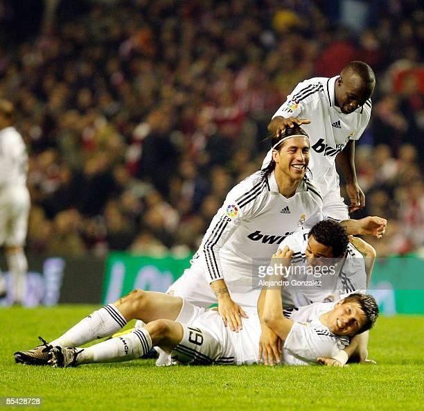 Klaas Jan Huntelaar of Real Madrid celebrates with Marcelo Sergio Ramos and Lassana Diarra his goal during the Liga match between Athletic Bilbao and...