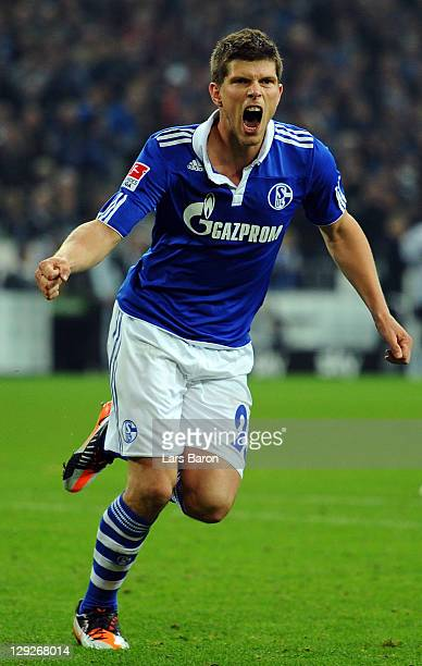 Klaas Jan Huntelaar of Schalke celebrates after scoring his teams first goal during the Bundesliga match between FC Schalke 04 and 1. FC...