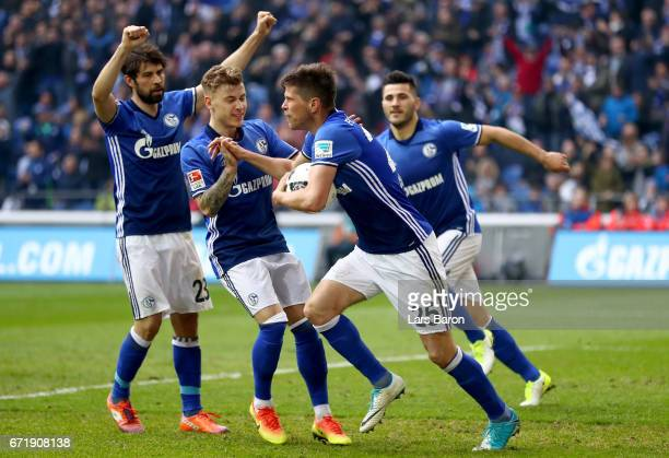 Klaas Jan Huntelaar of Schalke celebrates after scoring his teams first goal during the Bundesliga match between FC Schalke 04 and RB Leipzig at...