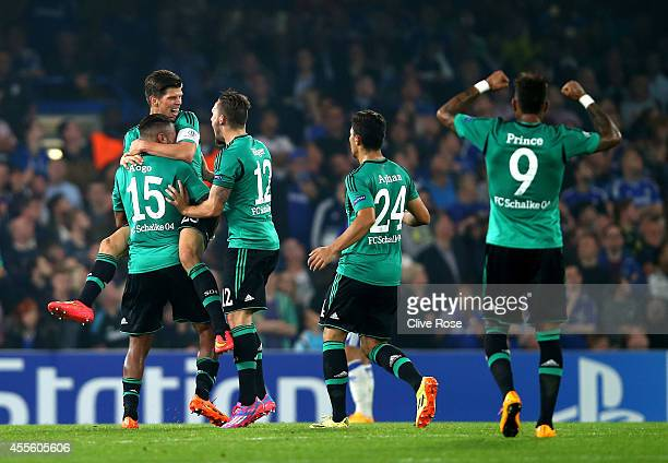 Klaas Jan Huntelaar of Schalke is comngtraulated by teammates after scoring a goal to level the scores at 1-1 during the UEFA Champions League Group...
