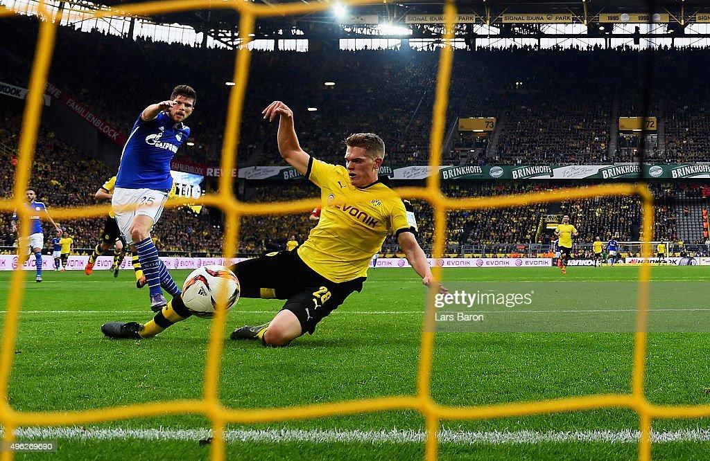 Klaas Jan Huntelaar of Schalke scores his teams first goal during the Bundesliga match between Borussia Dortmund and FC Schalke 04 at Signal Iduna Park on November 8, 2015 in Dortmund, Germany.