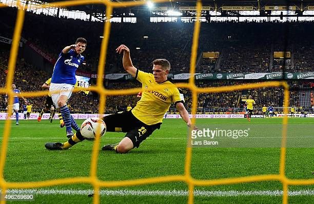 Klaas Jan Huntelaar of Schalke scores his teams first goal during the Bundesliga match between Borussia Dortmund and FC Schalke 04 at Signal Iduna...