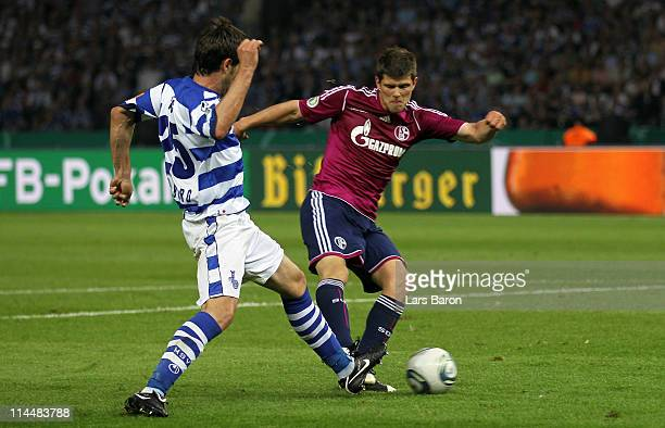 Klaas Jan Huntelaar of Schalke scores his teams fives goal during the DFB Cup final match between MSV Duisburg and FC Schalke 04 at Olympic Stadium...
