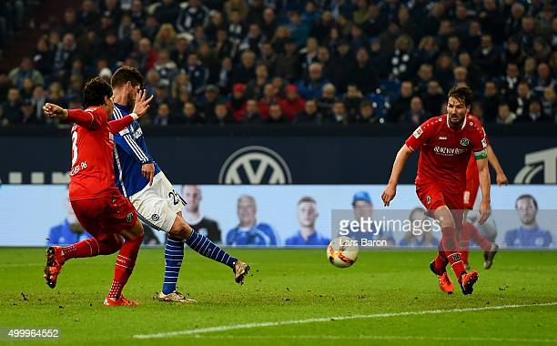 Klaas Jan Huntelaar of Schalke scores his teams second goal during the Bundesliga match between FC Schalke 04 and Hannover 96 at VeltinsArena on...